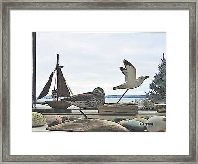 Woodcarvings In A Maine Window Framed Print