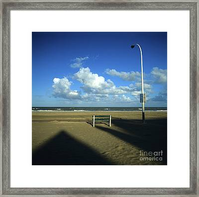 Wooden Bench In Front Of Ocean.deauville. France Framed Print by Bernard Jaubert