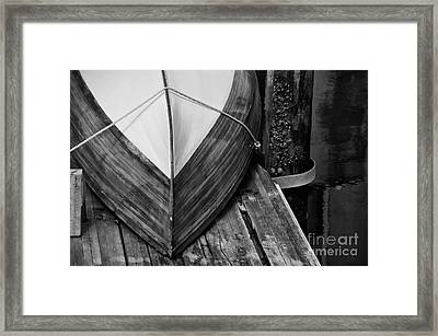 Wooden Boat On The Dock Framed Print by Wilma  Birdwell