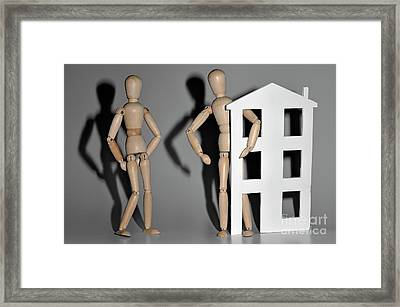 Wooden Mannequin Couple With A House Shape Framed Print by Sami Sarkis