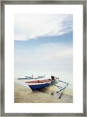 Wooden Outrigger Boat On Shore Framed Print by Carlina Teteris