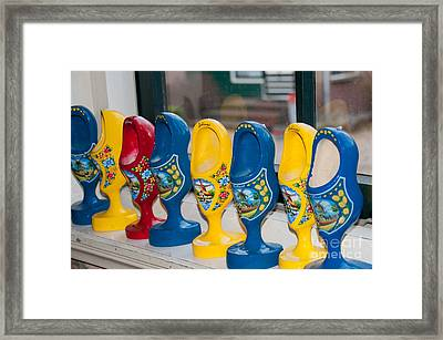 Wooden Shoes Framed Print by Carol Ailles