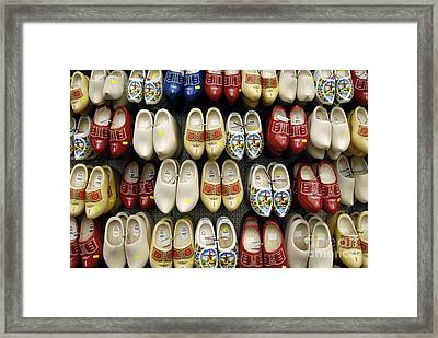Wooden Shoes Framed Print by Ed Rooney