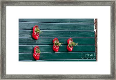Wooden Shoes On Teh Wall Framed Print by Carol Ailles