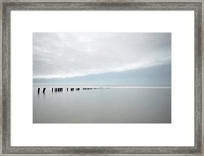 Wooden Stakes In Sea Framed Print by Amk