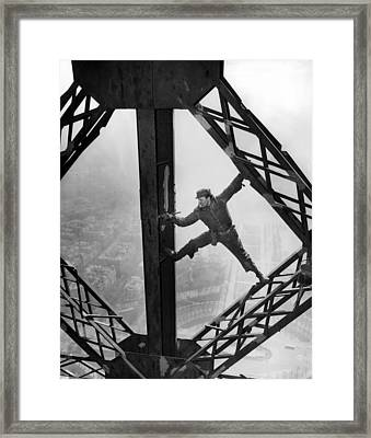 Worker Painting The Eiffel Tower Framed Print by Everett