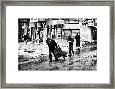 Working In Istanbul Framed Print by John Rizzuto