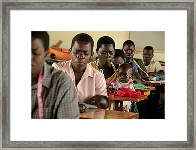 Working Parents And Children, Uganda Framed Print by Mauro Fermariello