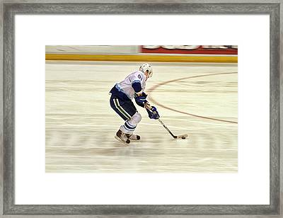Working The Puck Framed Print by Karol Livote