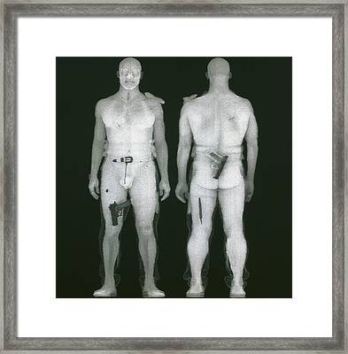 X-ray Views Of Man During Bodysearch Surveillance Framed Print by American Science & Engineering
