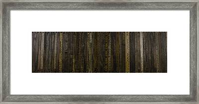 Yardsticks - Aged 18 Inch Framed Print by Kurt Olson