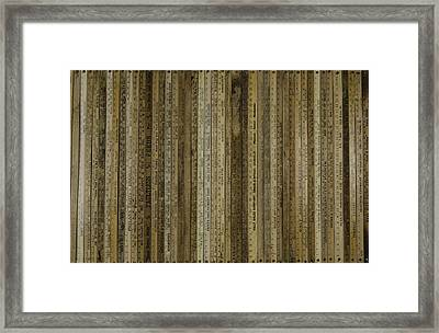 Yardsticks - Tan Framed Print by Kurt Olson