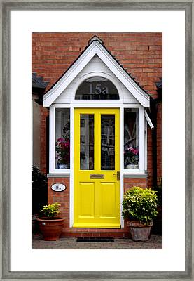 Yellow Door Framed Print by Roberto Alamino