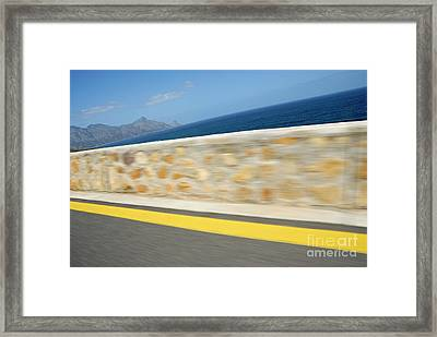 Yellow Line On A Coastal Road By Sea Framed Print by Sami Sarkis