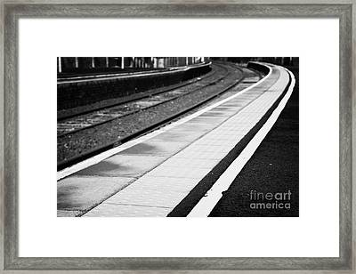 Yellow Warning Line And Textured Contoured Tiles Railway Station Platform And Track Northern Ireland Framed Print by Joe Fox