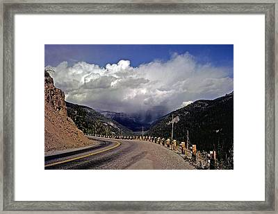 Yellowstone Under Lowering Skies Framed Print by Rod Jones