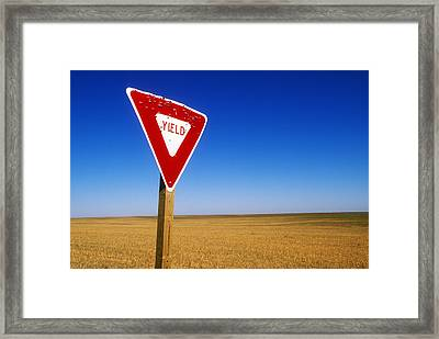 Yield Road Sign With Bullet Holes In It Framed Print by Wesley Hitt