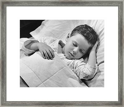Young Boy Asleep In Bed Framed Print by George Marks