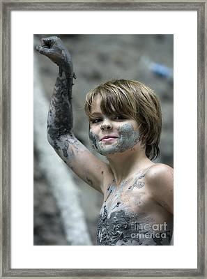 Young Boy Covered With Mud Framed Print by Christopher Purcell