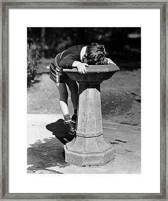 Young Boy Drinking From Water Fountain Framed Print by George Marks
