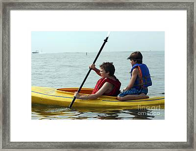 Young Boys Playing On A Kayak Framed Print by Christopher Purcell