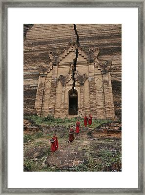 Young Buddhist Monks Near A Ruined Framed Print by Paul Chesley