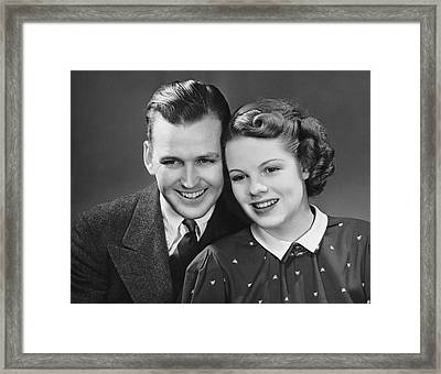 Young Couple Posing Together Framed Print by George Marks