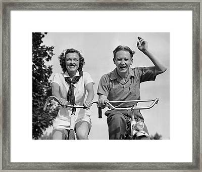 Young Couple Riding Bicycles Framed Print by George Marks