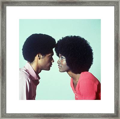 Young Couple Staring Into Eachothers Eye Framed Print by Archive Holdings Inc.