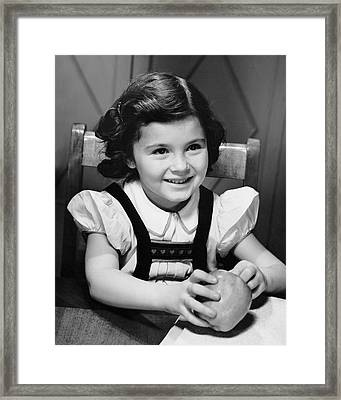 Young Girl Holding Apple Framed Print by George Marks