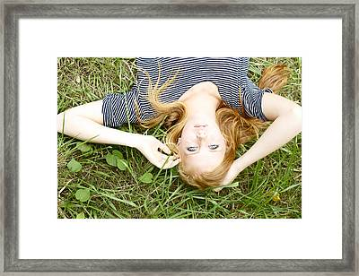 Young Girl On Grass Framed Print by Kicka Witte