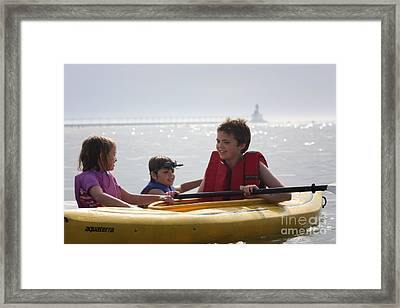 Young Kids Playing On A Kayak Framed Print by Christopher Purcell