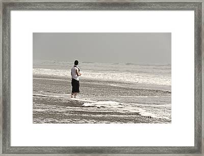 Young Man And The Pacific Ocean Framed Print by Yurix Sardinelly