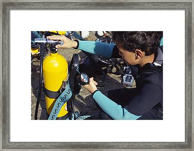 Young Scuba Diver Checking Kit Framed Print by Alexis Rosenfeld