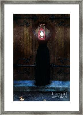 Young Woman In Black Lantern In Front Of Her Face Framed Print by Jill Battaglia