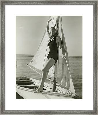 Young Woman Posing On Sailboat Framed Print by George Marks