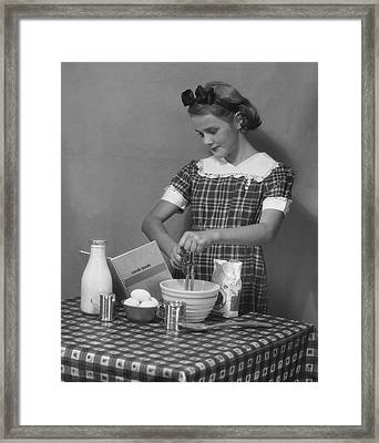 Young Woman Preparing Food Framed Print by George Marks