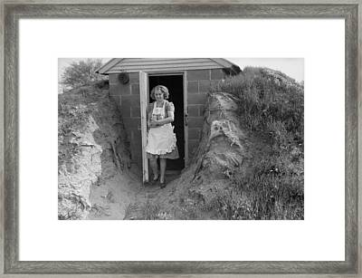 Young Woman Retrieves Home Canned Food Framed Print by Everett