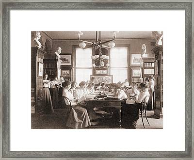Young Women Reading In Library Framed Print by Everett