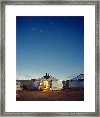 Yurt Under A Starry Sky In Mongolia Framed Print by Andrew Rowat