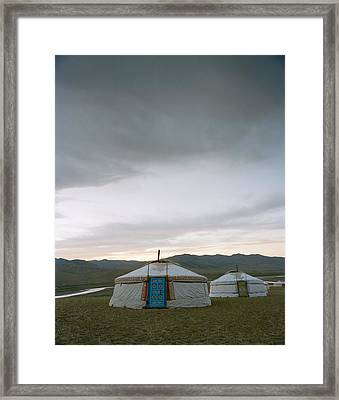 Yurts On The Wide Grassy Plains Of Mongolia Framed Print by Andrew Rowat