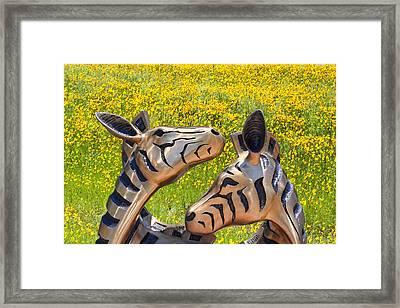 Zebra Sculptured Heads In Wildflowers Framed Print by Linda Phelps