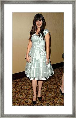 Zooey Deschanel In Attendance Framed Print by Everett