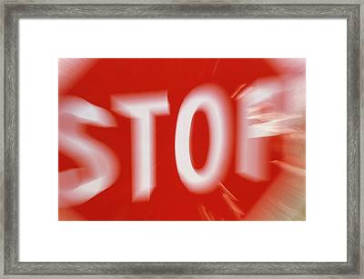 Zoom-effect Photo Of A Roadside Stop Sign Framed Print by Tony Craddock