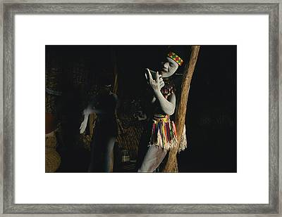 Zulu Women Put On Body And Facial Framed Print by Chris Johns