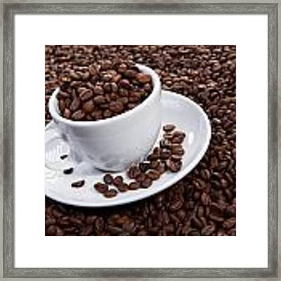 Cup Of Coffee Beans Framed Print by Raimond Klavins