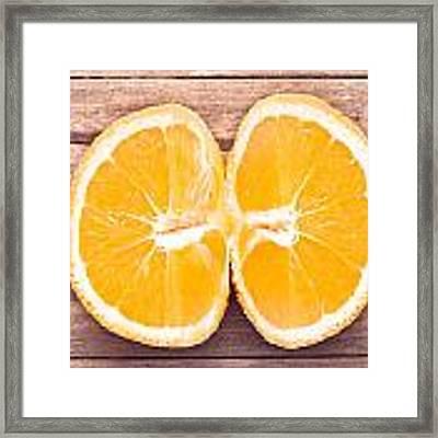 Orange Framed Print by Tom Gowanlock
