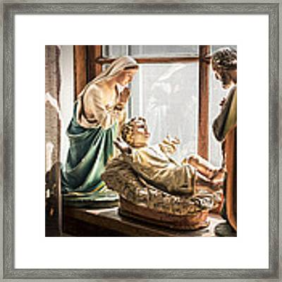 Baby Jesus Welcoming A New Day Framed Print by Nancy Strahinic