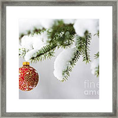 Christmas Ornament In The Snow Framed Print