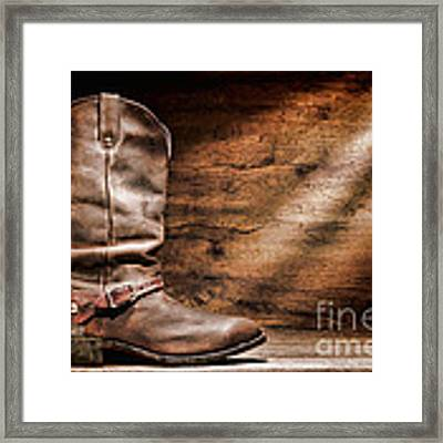 Cowboy Boots On Wood Floor Framed Print